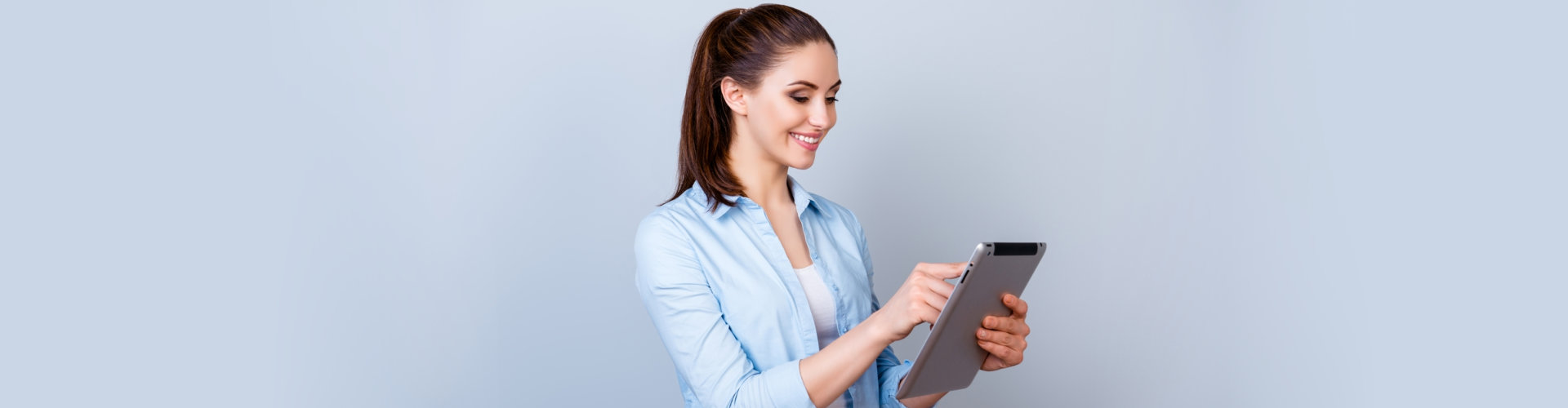 a woman holding a tablet