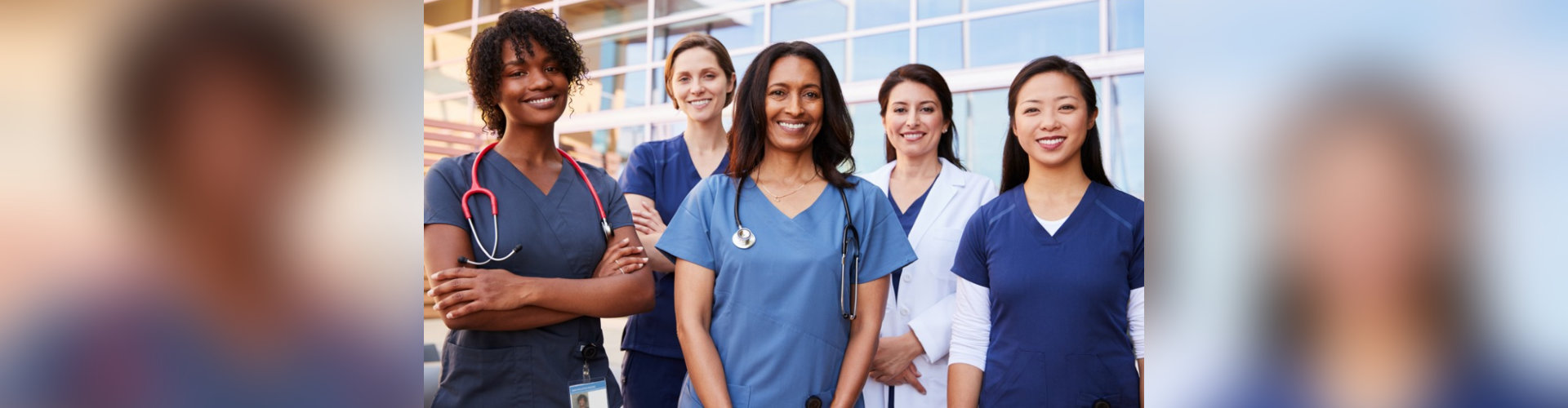 Female healthcare colleagues standing outside hospital