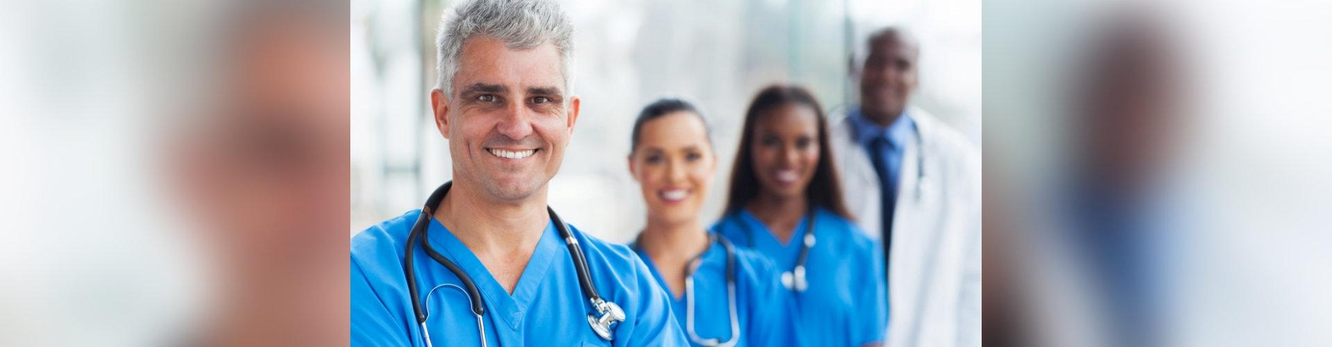 handsome senior medical doctor and team at hospital