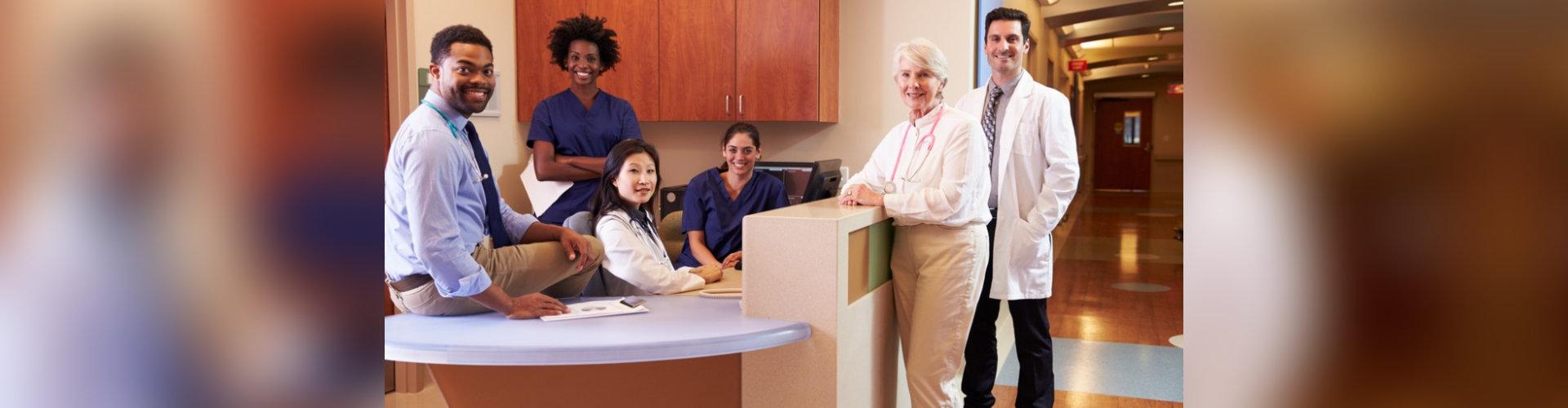 Portrait Of Medical Staff At Nurse s Station In Hospital